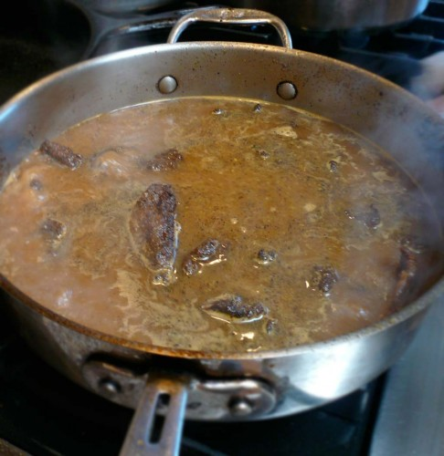Braising the lamb rillette meat
