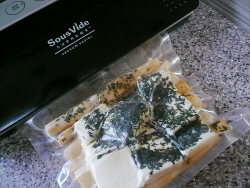 Sealing a bag of salsify with butter and herbs with my SousVide Supreme vacuum sealer